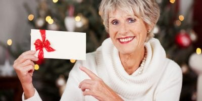 Picture of woman holding a gift voucher